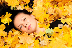 The attractive woman in autumn leaf Royalty Free Stock Images