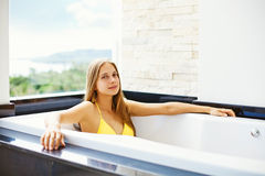 Attractive woman on a balcony Stock Image
