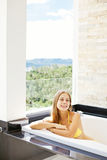 Attractive woman on a balcony Royalty Free Stock Photography