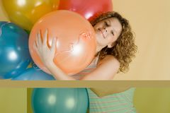 Attractive woman with balloons Stock Images