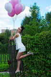 Attractive woman with balloons Stock Photos