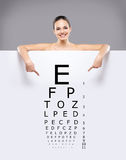 Attractive woman with a banner of test vision table Royalty Free Stock Photos