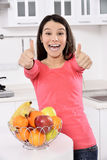 Attractive woman with basket of fruits Stock Images