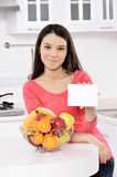 Attractive woman with basket of fruits Stock Photos