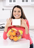 Attractive woman with basket of fruits Royalty Free Stock Photos