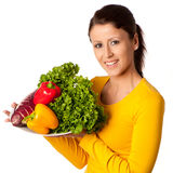 Attractive woman with basket of vegetables Royalty Free Stock Images