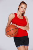 Attractive woman with a basketball royalty free stock image