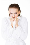 Attractive woman with a bathrobe Royalty Free Stock Images