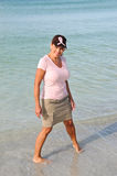 Attractive Woman on the Beach Wearing Pink Ribbon Royalty Free Stock Photos