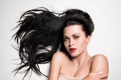 Attractive woman with beautiful composed hair. Isolated on white royalty free stock image