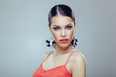 Attractive woman with beautiful earrings posing in a studi Stock Photo