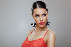 Attractive woman with beautiful earrings posing in a studio Royalty Free Stock Photo