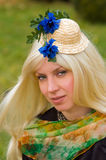 Attractive woman with a beautiful headdress. Attractive young woman with a beautiful headdress Royalty Free Stock Image
