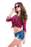 Attractive woman with beautiful long curly hair in pink sunglasses Royalty Free Stock Image