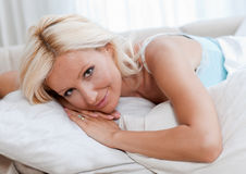 Attractive woman in bed stock photography