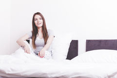 Attractive woman in the bed. Stock Images