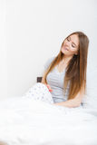 Attractive woman in the bed. Royalty Free Stock Photography