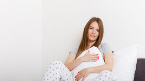 Attractive woman in the bed. Stock Photography