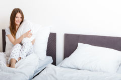 Attractive woman in the bed. Royalty Free Stock Photos