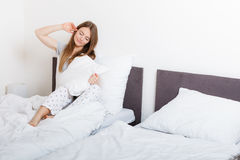 Attractive woman in the bed. Royalty Free Stock Photo