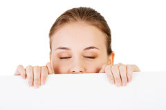 Attractive woman behind a copy space. Royalty Free Stock Images
