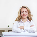 Attractive woman behind flipchart Stock Images