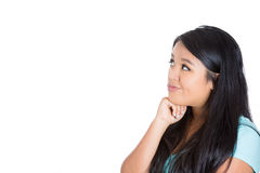 Attractive woman being skeptical and thinking Royalty Free Stock Images