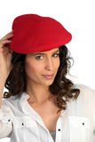 Attractive woman in a beret. Attractive woman in a red beret Stock Photos