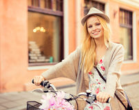 Attractive woman with bicycle in the city Royalty Free Stock Images