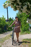 Attractive woman on a bicycle in spring Royalty Free Stock Photography