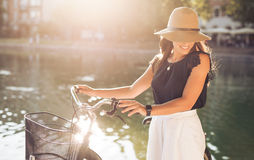 Attractive woman with bike at park stock images