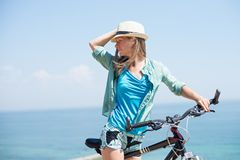 Attractive woman with bike. At the sea Stock Photo