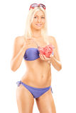 Attractive woman in bikini eating watermelon Royalty Free Stock Photography