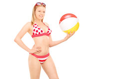 Attractive woman in bikini holding a beach ball Stock Photography