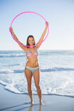 Attractive woman in bikini playing with hula hoop Royalty Free Stock Photography