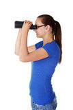 Attractive woman with binoculars Royalty Free Stock Photos
