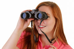 An attractive woman with binoculars Stock Photography