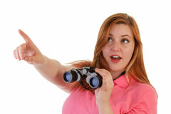 An attractive woman with binoculars Royalty Free Stock Images