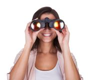 Attractive woman with binoculars Royalty Free Stock Image
