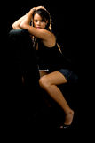 Attractive woman on black stock photos