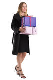 Attractive woman in black coat with gifts, isolated on white Stock Images