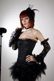 Attractive woman in black corset and tutu skirt Royalty Free Stock Image