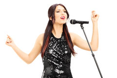 Attractive woman in black dress singing Royalty Free Stock Image