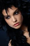 Attractive woman with black feather boa Royalty Free Stock Image