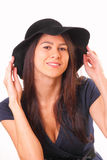 Attractive woman in a black hat Stock Photo