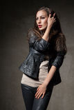 Attractive woman in black leather jacket and pants Stock Image