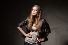 Attractive woman in black leather jacket and pants Royalty Free Stock Images