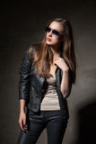 Attractive woman in black leather jacket and pants Royalty Free Stock Photos