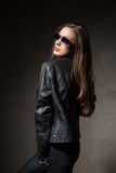 Attractive woman in black leather jacket and pants Stock Photos