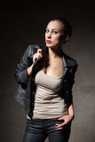Attractive woman in black leather jacket and pants Royalty Free Stock Photo